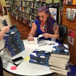 Maria signing books